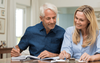 woman-and-man-looking-at-bills