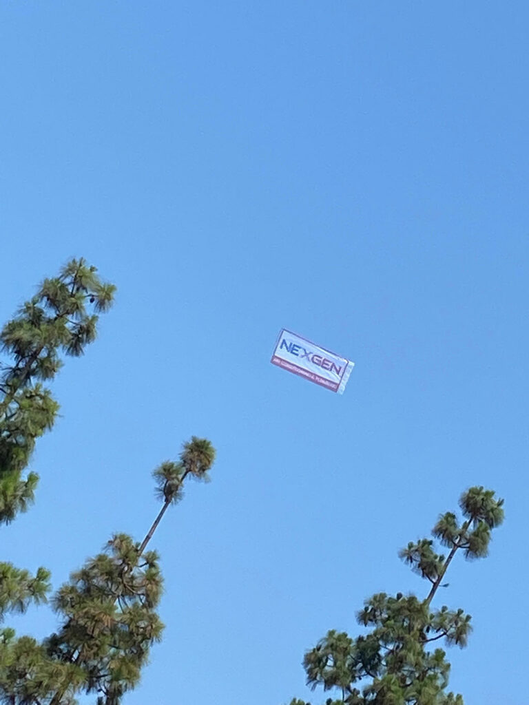 nexgen banner flying over our headquarters in a blue sky