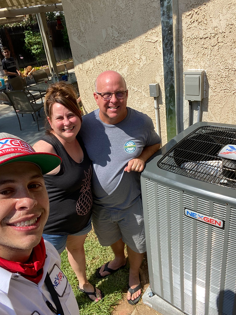 happy customers with new ac unit