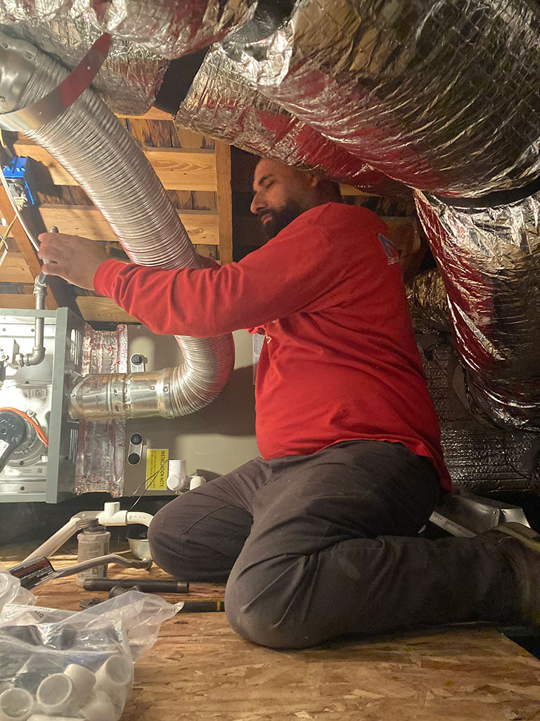 a person working on a heater