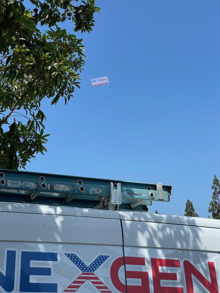 nexgen banner flying over
