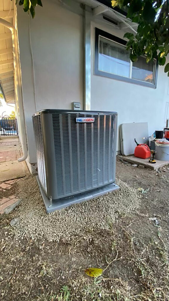 a photo of a cooling system outside a house